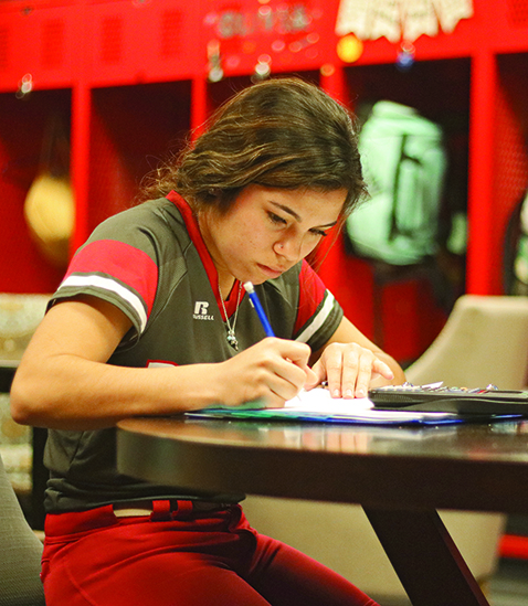 Senior Tiffany Licon does her math homework, using her time while she has it. Tiffany is a softball player and is one of many student athletes who has to miss school often because of games and tournaments.