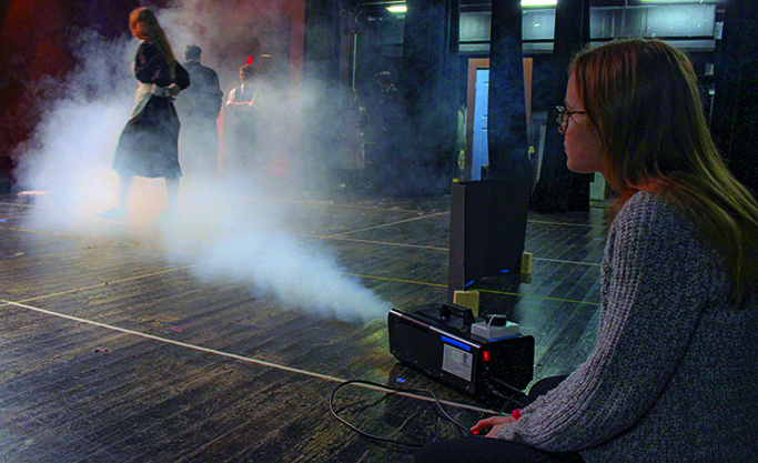 PROVIDING PIZAZZ: Alyssa Shumaker operates the fog machine to add  are to the UIL show, Violet Sharp. The Violet Sharp production cast and crew's hard work did not go unnoticed at competition because they won several awards including the Outstanding Crew award.