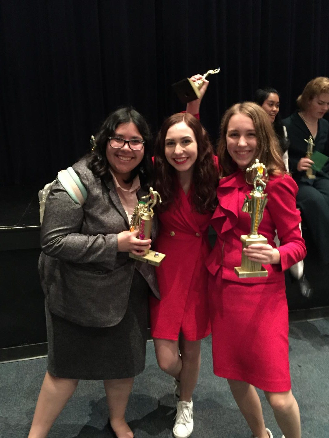 Senior Amy Shreeve, pictured far right by junior Ashlyn Dahl (center), and senior Brianna Rodriguez (far left) was one of the many students who competed at the Speech and Debate tournament this weekend at Anderson High School. James Bowie High School performed exponentially well in the tournament, JBHS had multiple students win individual awards, become congressional debate finalists, and had two new state qualifiers, one being Amy Shreeve.