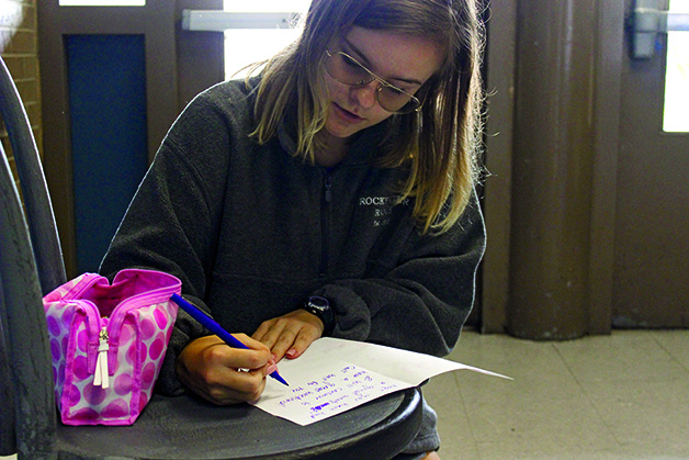 FOCUSING ON KINDNESS:  Alyssa Poole makes a card for her buddy, these cards are used by the members of Bowie Buddies to show kindness to their buddies and to check in with them from week to week.  Along with letters, they also have face painting and celebrations on spirit days.