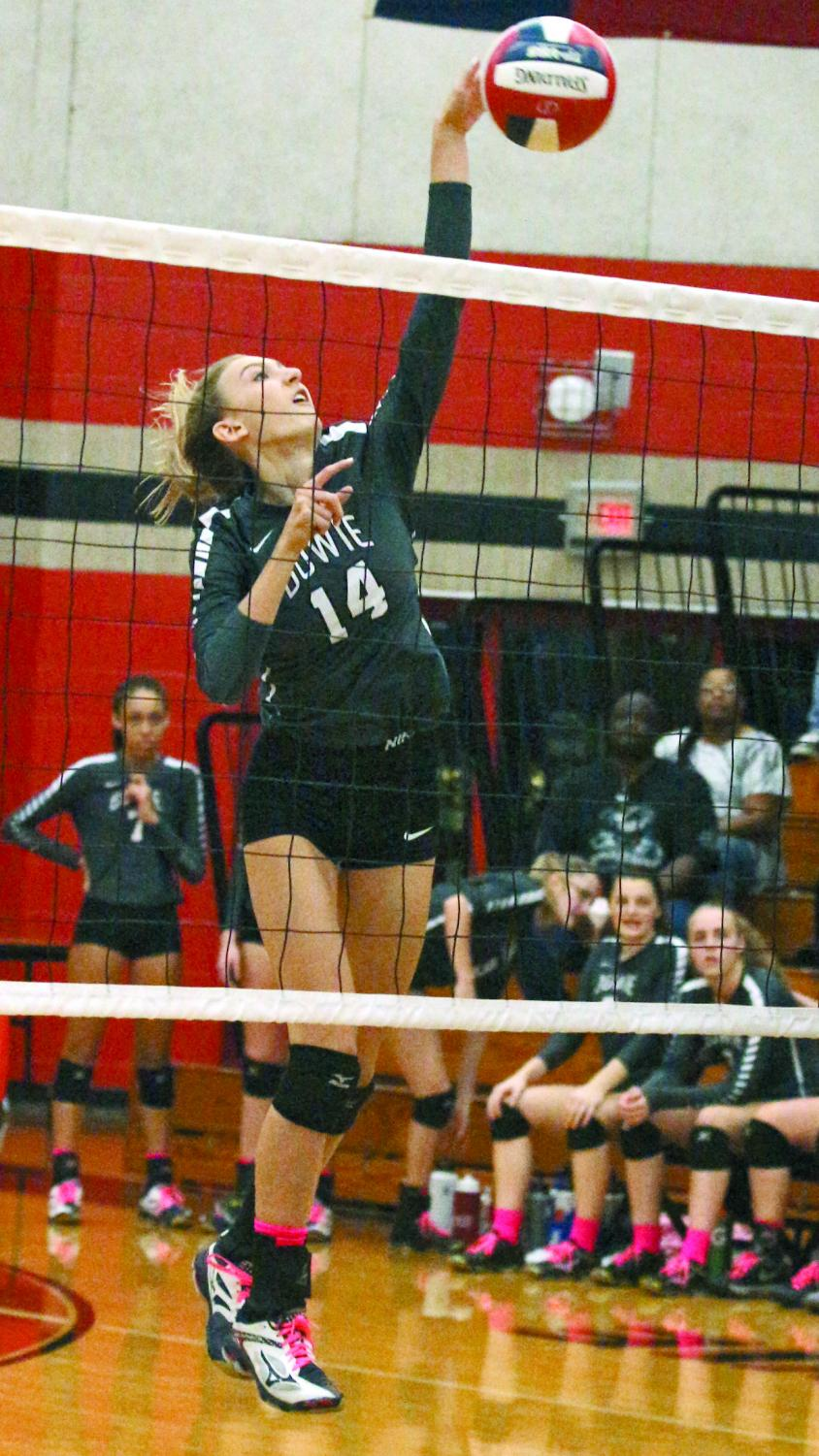 KILLING IT: Freshman Katherine Crosley spikes the volleyball over the net. Crosley plays setter and hitter.