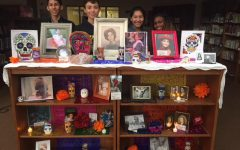 (Left to right) Philip Weiss, Alex Araiza, Sandy Benitez, and Cyn Torrey Smith are members of the Spanish Club and have worked together to create an Ofrenda in the library to commemorate the loss of loved ones known by the Bowie faculty and staff.