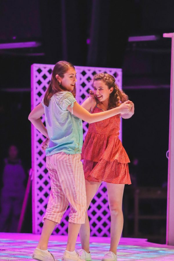 Kaia Pierce (left) and Maya Gerdes (right) show off their costumes as they perform Mamma Mia