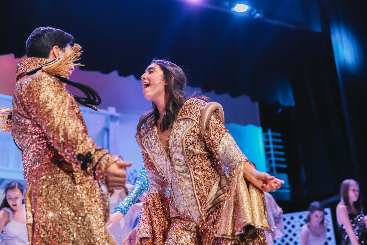 Eric Larson (Left) and Kamryn Morales  (Right) perform Mamma Mia in their breathtaking gold costumes