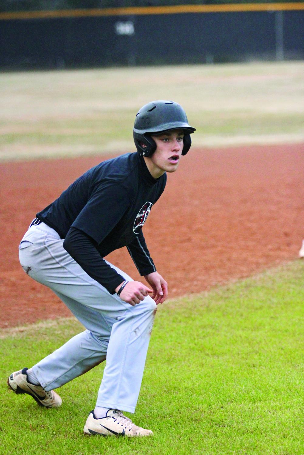 GETTING TO  THIRD BASE: Senior Seth Werchan prepares to sprint to home base. Werchan will attend the University of Pennsylvania to play baseball.