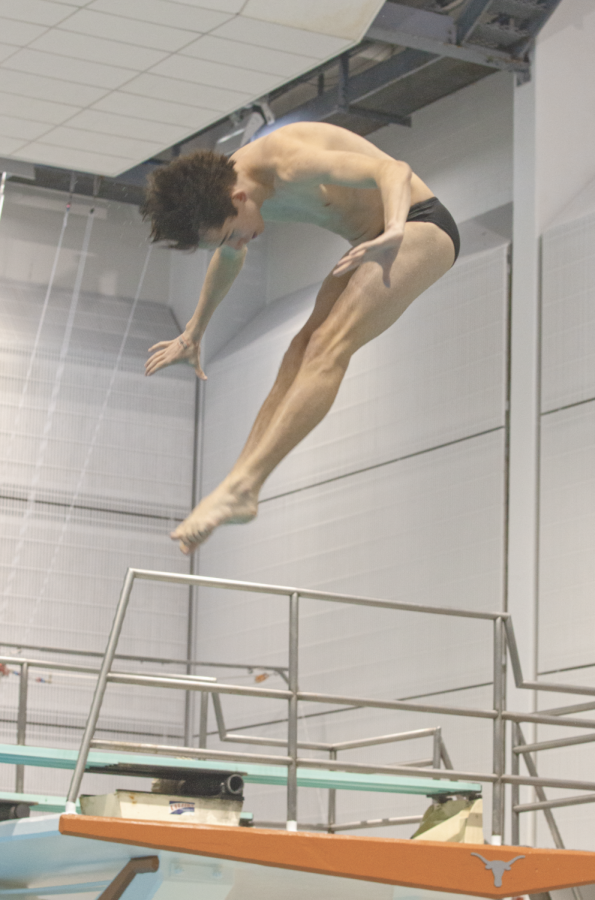 Diver takes off somersaulting all the way to the state