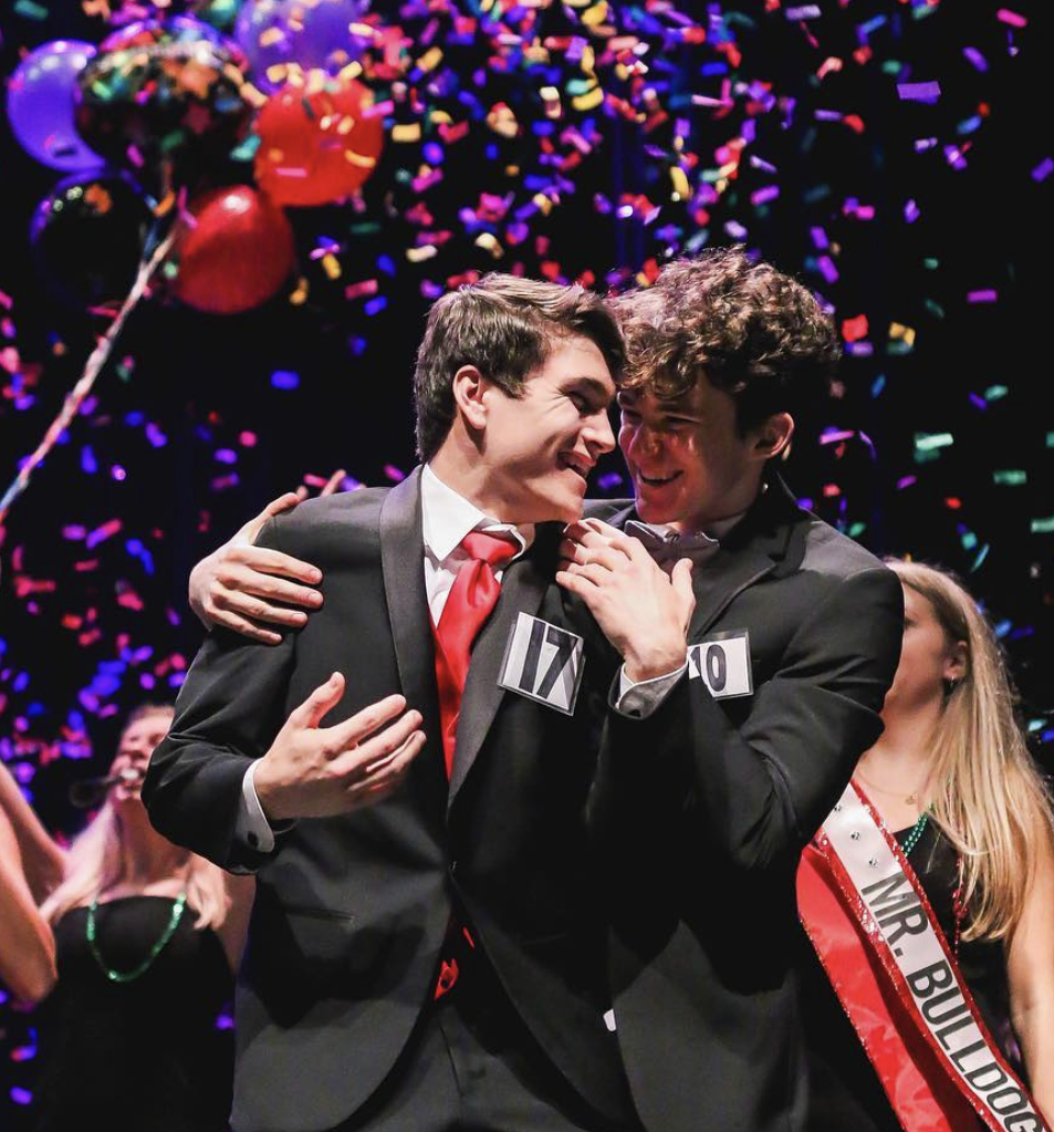 SHOCKED: Senior Stephen Achilles is congratulated by fellow contestant senior Harrison Louis after winning Bowies annual Mr. Bulldog competition.