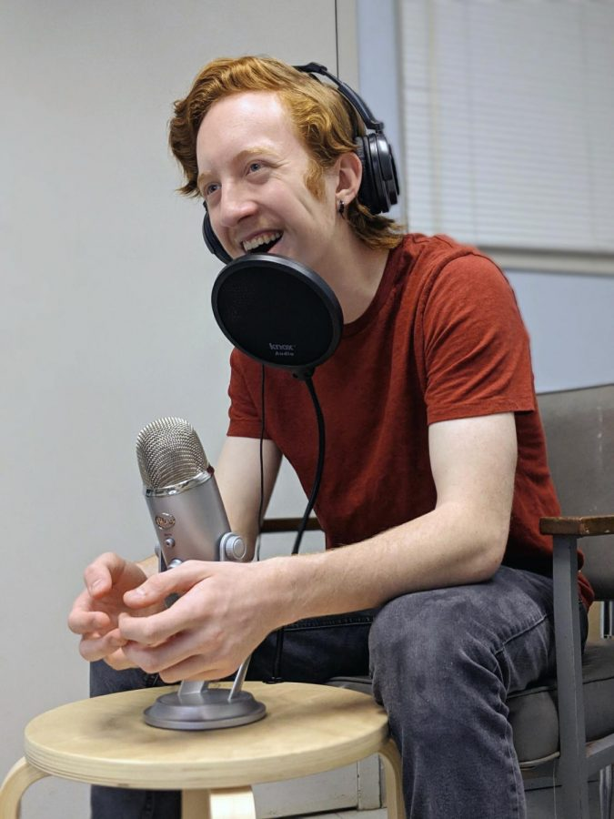 Podcast+host+Sophomore+Austin+Civatte+laughs+while+interviewing+for+a+new+episode.+