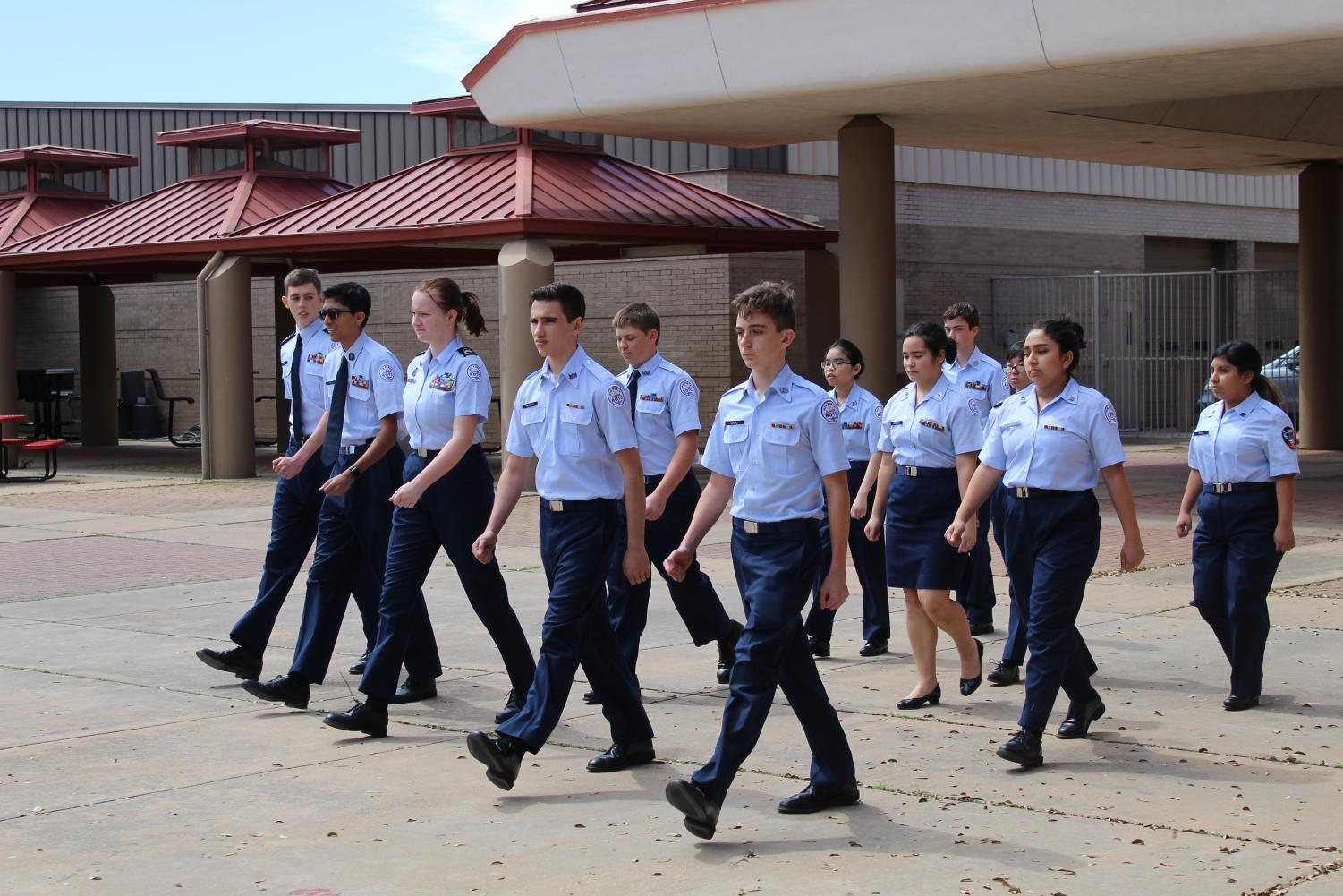 Within the JROTC class, students are taught leadership and military skills for half of each class on Mondays through Thursdays. On Fridays, JROTC practices outside.
