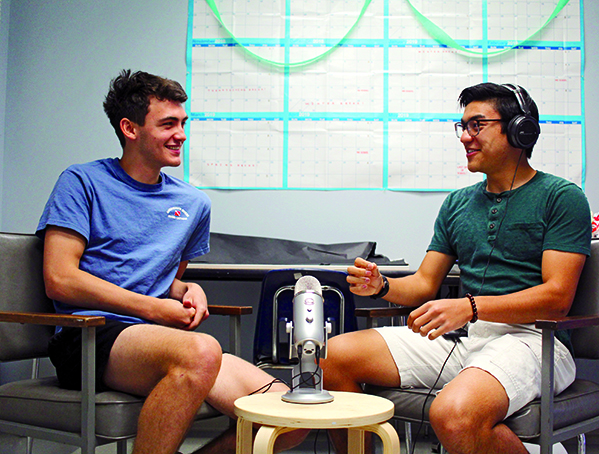 DEEP IN CONVERSATION: Seniors Will Pajak and Stephen Do laugh as they talk about some new podcast topics for their upcoming episodes. The podcast has quickly gained listeners and fans as it spreads to multiple countries all over the world as well as here in the U.S. PHOTO BY Preston Rolls