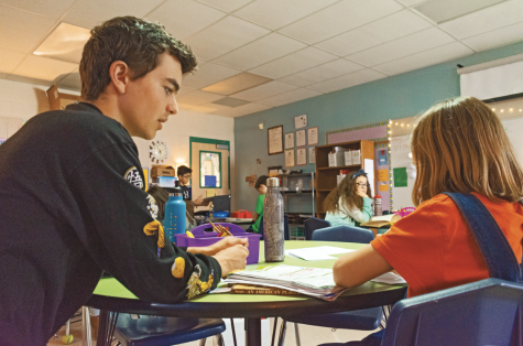 SHOWING APPRECIATION: Junior Michael Sugrue works with one of his fourth graders on their Mother