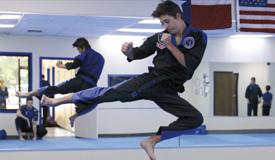 "IN THE AIR: Mid-jump, sophomore Sean McCulloch soars through the air. Sean has been learning and competing in taekwondo for 14 years. ""Everyone thinks if you do taekwondo you're a ninja and everyone thinks you just go to tournaments and knock each other out,"" Sean said. ""But that's not normally the case."""