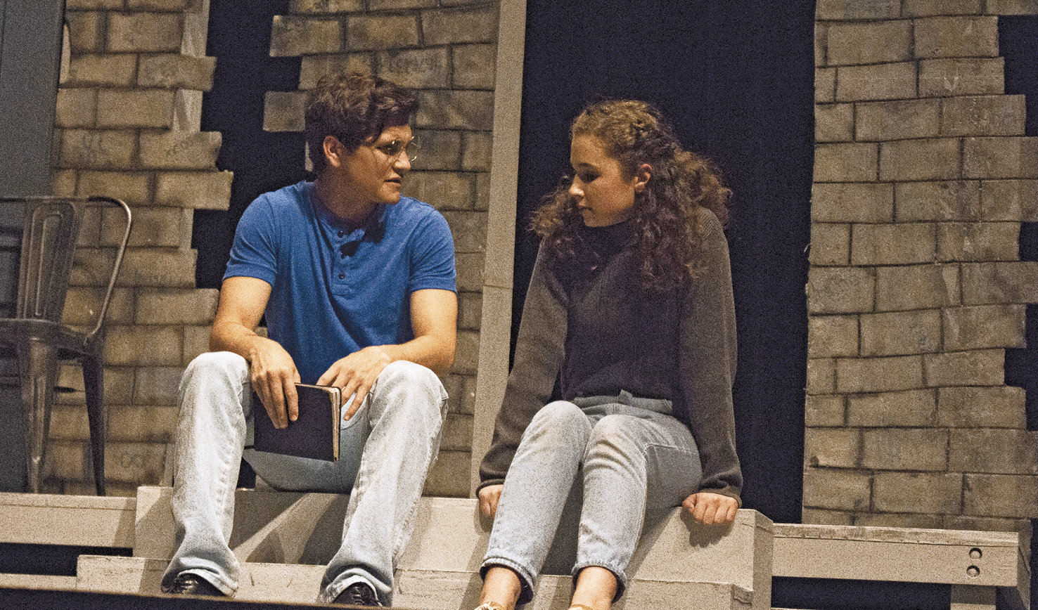 """NAIL THE ROLE: Sophomore Maia Gerdes plays Catherine and senior Stephen Achilles plays Hal in the senior one act """"Proof"""". The play, directed by senior Grace Clark, tells the story of Catherine's struggle with mental health after the death of her father."""