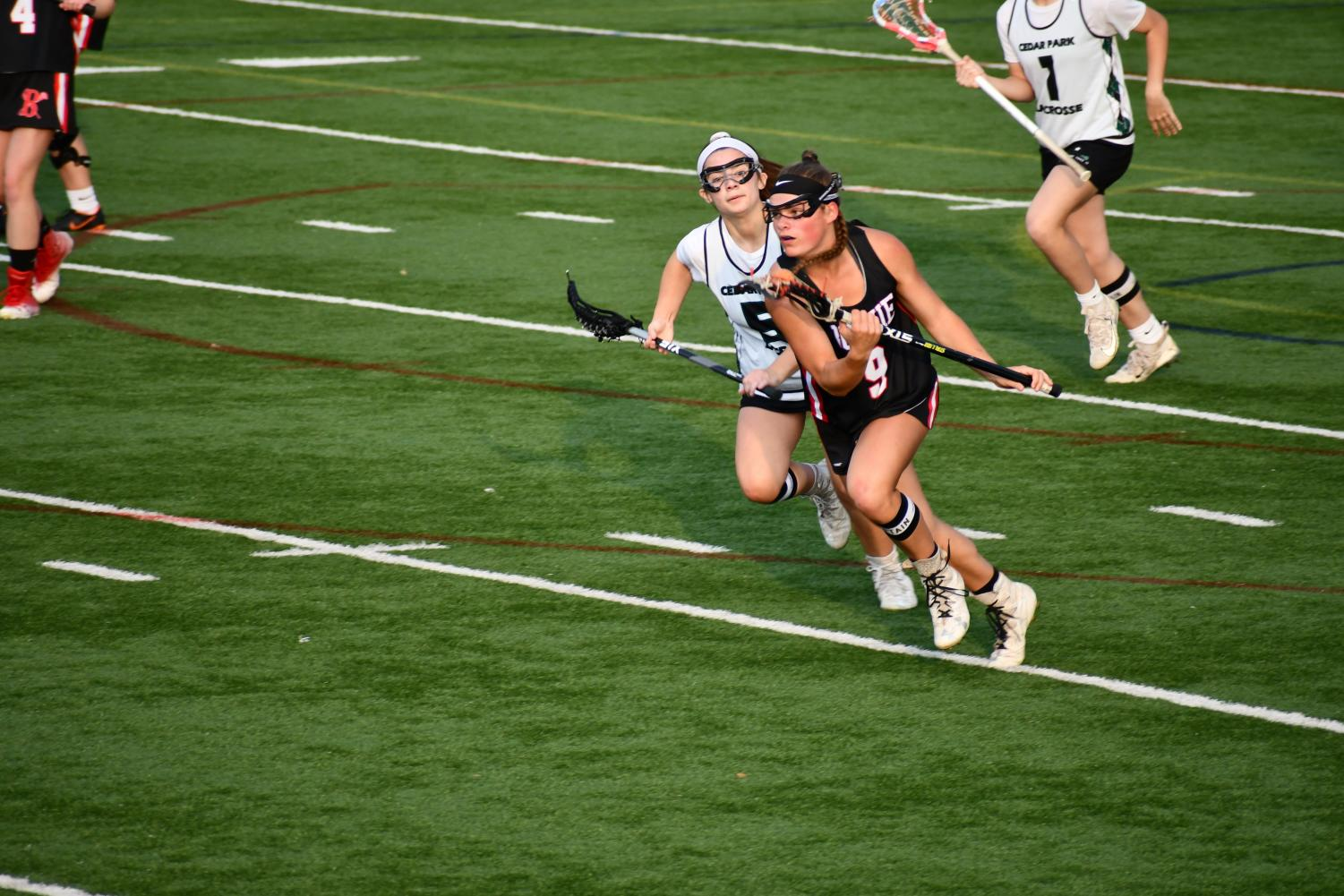 ON THE MOVE: Junior Sydney Heim sprints down midfield towards the goal. Heim was awarded with All-American and All-State honors this season.
