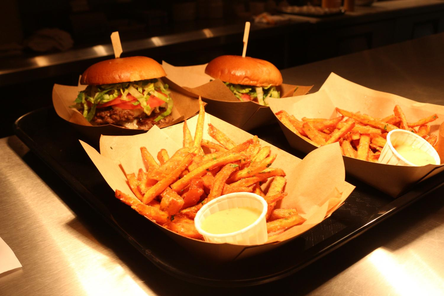 GETTIN' THE GRUB: Lil' Doddy's Classic Cheeseburgers and truffle fries are ready to be served up. The classic cheeseburger comes with lettuce, tomato, cheese, and an option of one or two quarter pound patties, all at the price of around $7, with no add-ins.