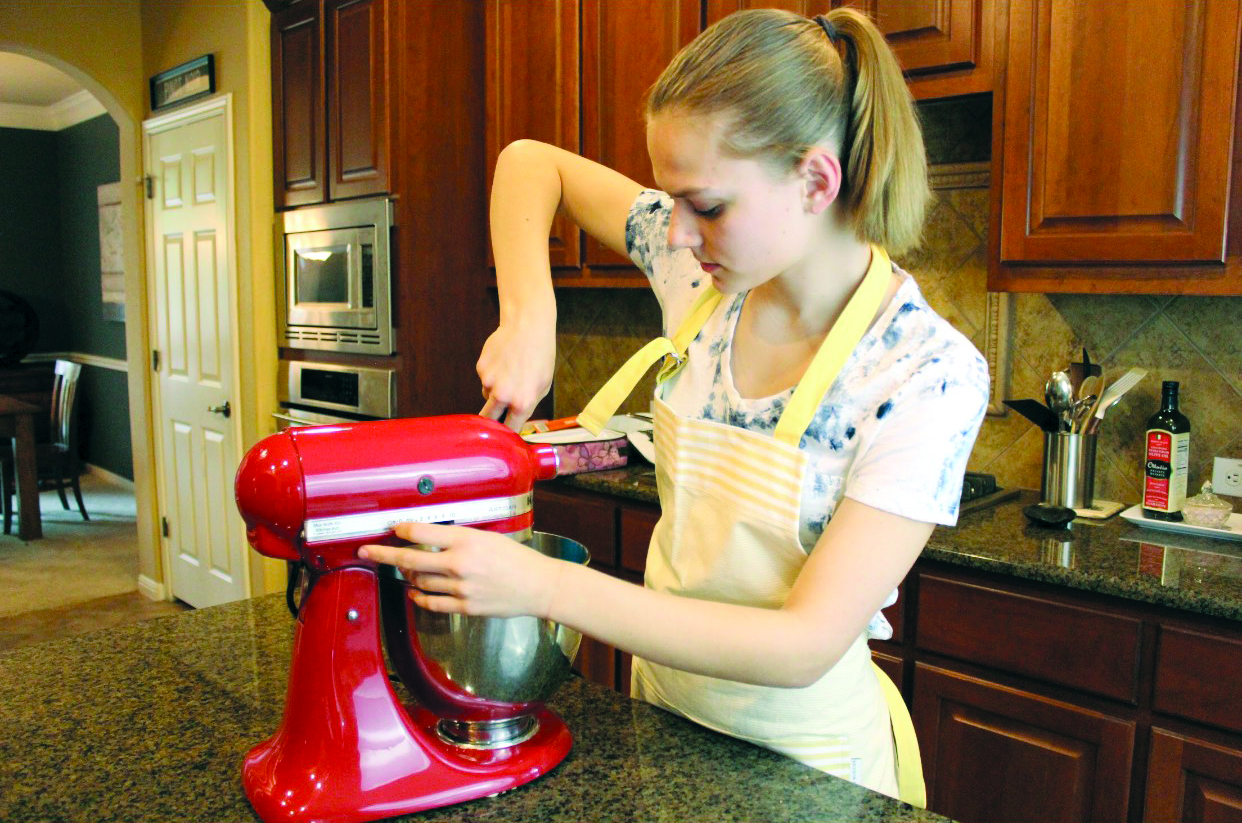 THE WAY THE COOKIE CRUMBLES: Sophomore Mariah Barsotti prepares cookie batter for her baking busi- ness: Mariah Makes. Barsotti's business has been running since Valentines Day of 2018, and she primarily sells to her peers during holiday seasons as well as family friends.