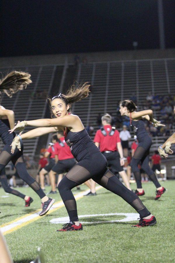 Senior Audrey Vera performs during halftime alongside her color guard peers.