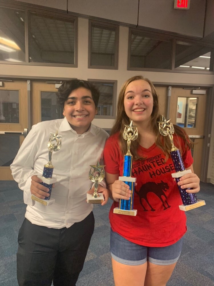 Sophomore Erin Everette (right) and sophomore Daniel Bamdad (left)  both received trophies for placing at the Pflugerville TFA Swing tournament this past weekend.