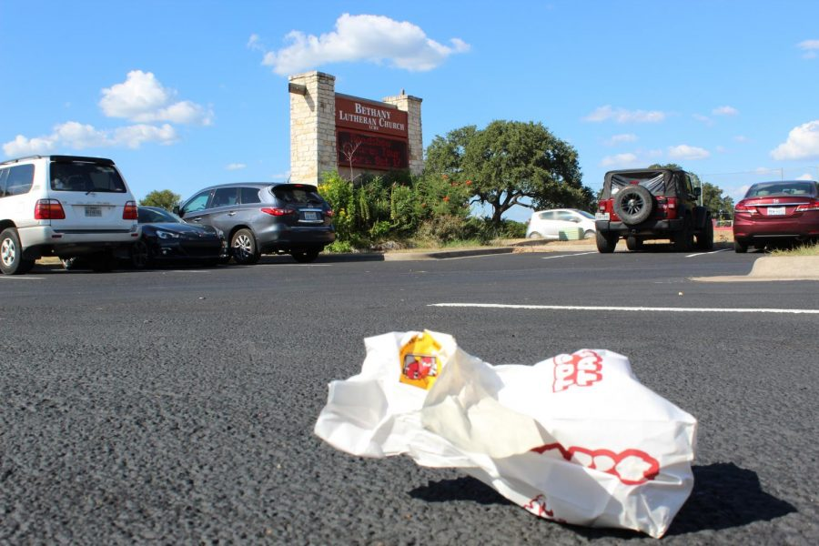 A paper bag placed on the Bethany church parking lot