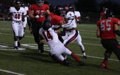 Varsity football team plays with injuries