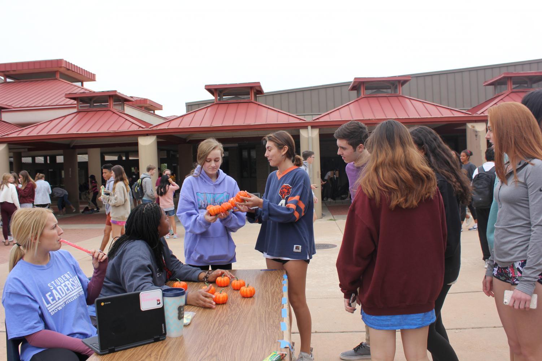 Leadership students, seniors Erin Rannefeld and Andrea Otti run one of the many activities set around the courtyard.