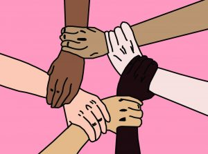 Hands hold each other by the wrist, symbolizing unity as they are all different ethnicities.
