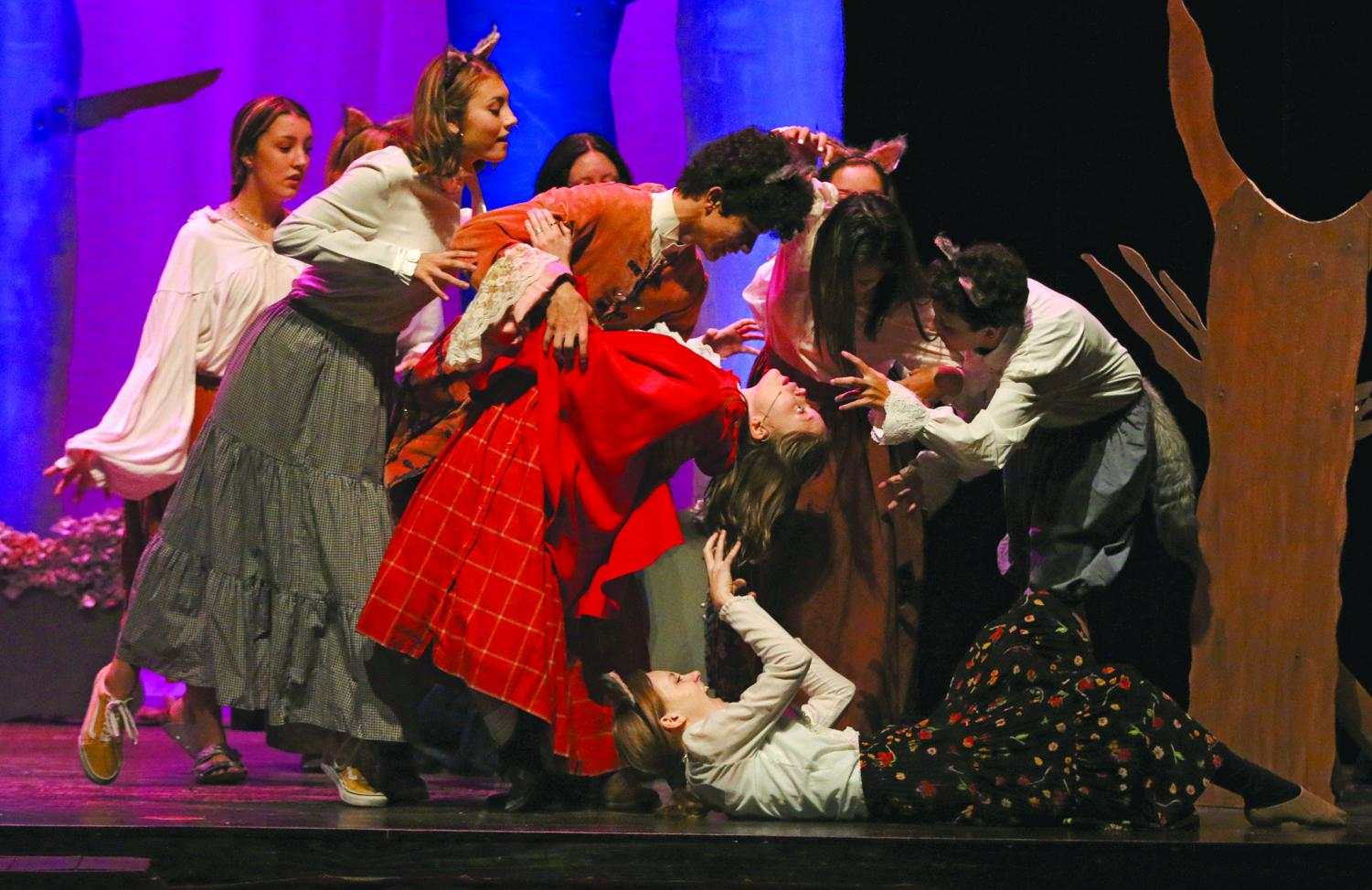 """DANCING WITH THE BIG BAD WOLF: Junior Haley Pousson dances with Junior Jaden Davis and his entourage of wolves. Pousson played the role of Little Red Riding Hood, while Davis played The Big Bad Wolf. """"Little Red is on a journey to bring bread and supplies to her grandmothers house in the woods,"""" Pousson said."""