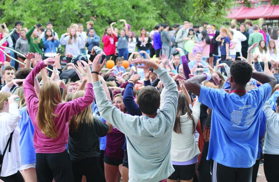 "GETTING DOWN IN THE PIT: Bowie students join together in the pit to dance together.  At the end of the Fall Fest, all of the students outside gathered in the pit to create lasting bonds together. ""The Fall Fest is a good way to start off the school year by fostering school community and bringing everybody together,"" senior Kendall Oh said."