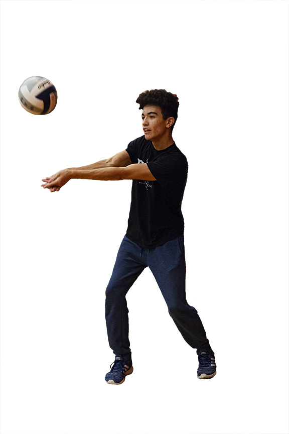 MIDDLE+BACK%3A+Junior+Jaden+Davis+returns+a+pass+from+the+back+row.+His+passion+for+volleyball+led+him+to+join+a+club+team+outside+of+Bowie+as+well.+