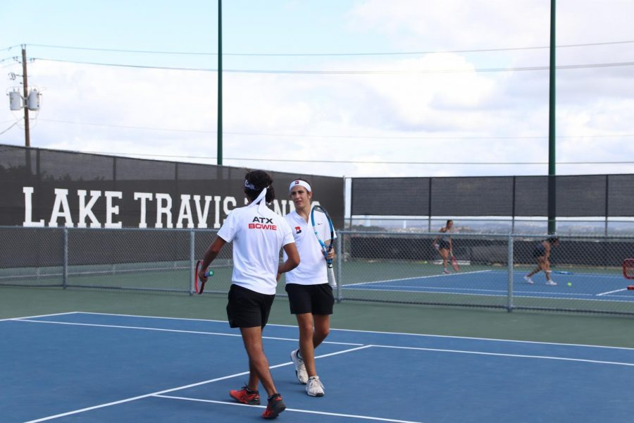 """PAIRING UP: Seniors Arik Suez and Carlos Canepa compete together in their doubles match. In practice the team does compete with each other and in their pairs. """"I've played with or against every one on varsity and that kind of practicing really allows us to get to know each other  and every ones playing style on the team,"""" Canepa said."""