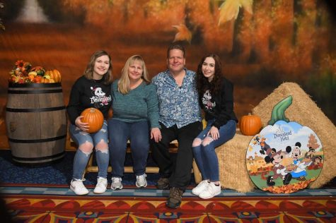 FAMILY VALUES: sophomore Lindsay Dahl [left] poses with her parents [center] and senior Ashlyn Dahl [right]. Going to Disneyland is a staple of their family traditions.  Image courtesy of Lindsay Dahl