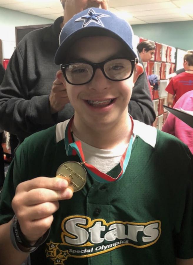 Senior Noah Casarez wins a gold medal at the Special Olympics Bowling Tournament.