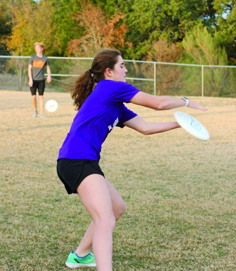 CAPTAIN STATUS: Senior Caroline Myers catches the frisbee during practice. She played ultimate in middle school before joining the Bowie team.