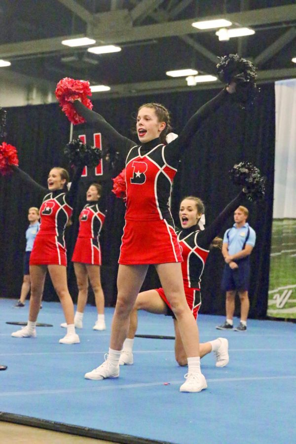 ATTACK THE CROWD: Madison Noe calls out a cheer and engages the crowd. The JV team placed 2nd in the UCA Fall Regional competition.