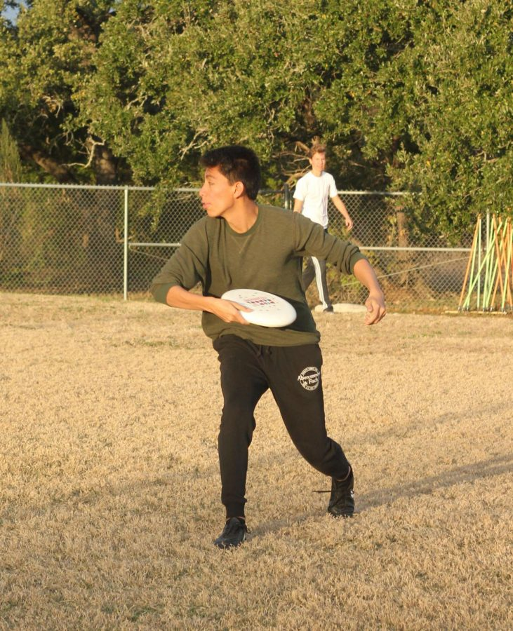 Junior Christian Garcia Pecina players ultimate frisbee at practice. He is a third year member of the team.