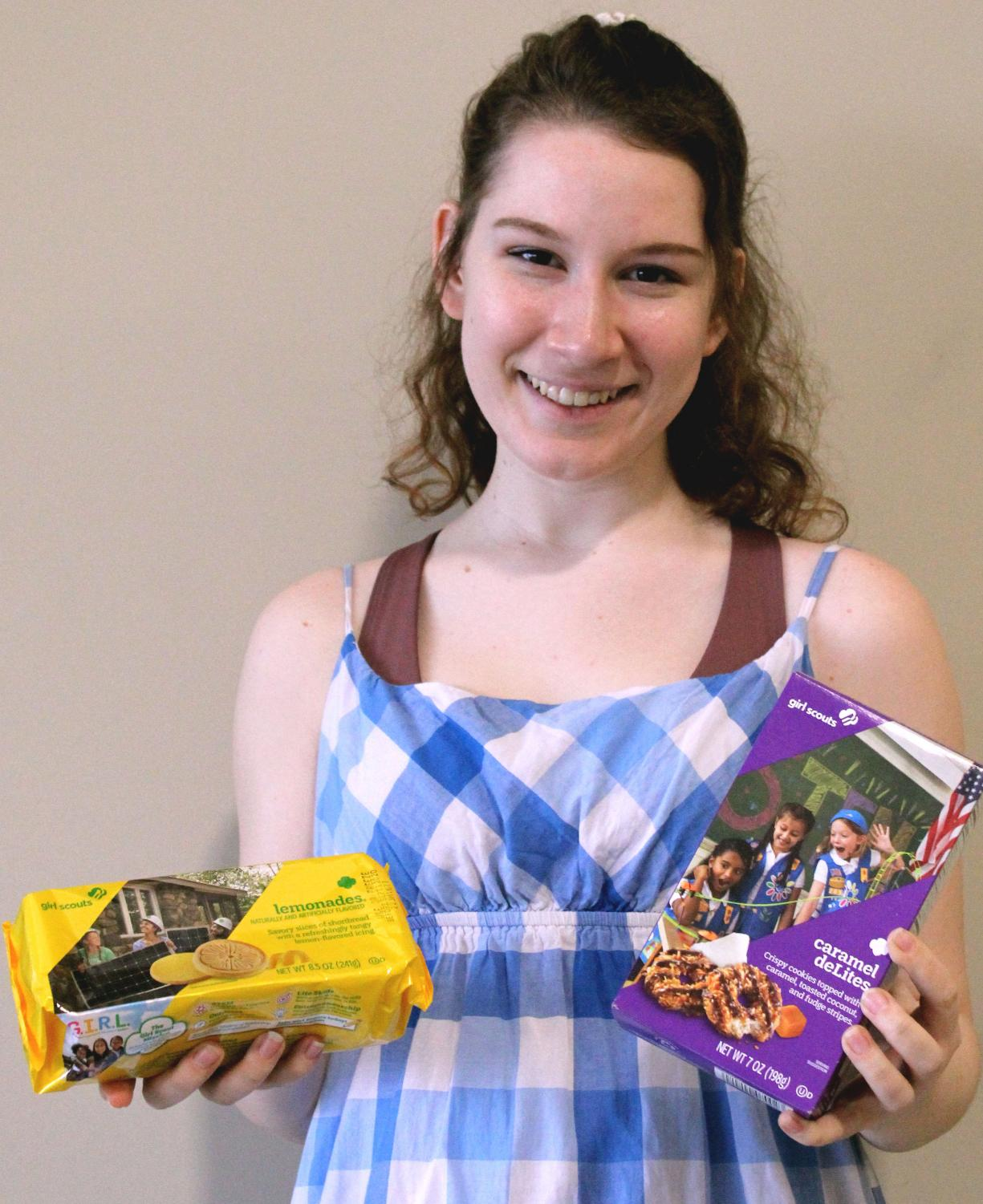 Girl+Scout+Ambassador+Elizabeth+Cluchey+smiles+while+holding+her+favorite+Girl+Scout+cookies%2C+Lemonades+and+Carmel+deLites.+In+order+to+attract+more+customers%2C+Cluchey+accepts+%2C+cash%2C+credit%2C+and+Apple+Pay+as+appropriate+payment+methods.+%0A