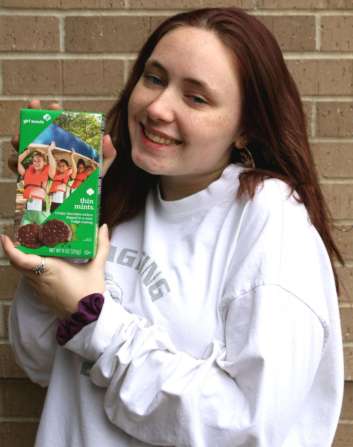 Girl+Scout+Ambassador+Faith+Lawrence+holds+up+her+favorite+box+of+Girl+Scout+cookies%2C+Thin+Mints.+In+addition+to+cash+and+check%2C+Lawrence+accepts+credit+as+a+payment+method.+%0A