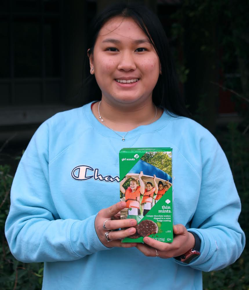 Girl+Scout+Ambassador+Jade+Bach+poses+with+a+box+of+Thin+Mints%2C+the+organization%E2%80%99s+most+popular+cookie.+Bach+is+excited+to+use+her+profits+to+fund+exciting+adventures+with+her+troop.+%0A%0A