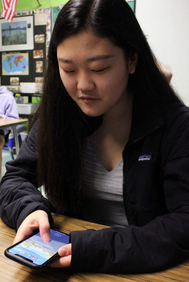 ON YOUR MARKS: Sophomore Yuri Lee spends time the world of Mario Kart, racing against her classmates on the new app.
