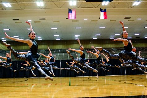 FLYING HIGH: The Silver Stars jump into a fire bird in the middle of their team jazz. The team has been practicing this piece since early December.