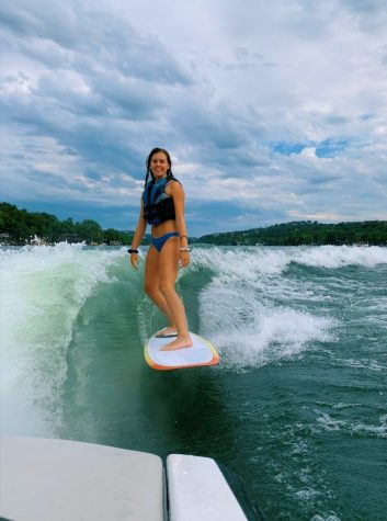 "Brooke Garner is a junior who has a hobby of surfing. ""I started surfing when I was four years old,"" Garner said. ""My family owned a boat back then, so my dad was able to coach me. Currently I surf behind a boat that we rent out on Lake Travis or behind a cable at a cable park I go to called the Texas Ski Ranch."" Photo Courtesy of Brooke Garner."