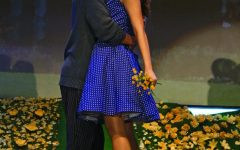 """THE SMOOCH OF A LIFETIME: After three years of waiting, Edward Bloom played by junior Jaden Davis, finally finds the love of his life, Sandra, played by senior Gillian Griffis. He worked for a circus master during those three years and every month he would give him a clue of his mystery girls identity, with his last clue being that she loved daffodils. """"Before walking on stage for daffodils I take a second to get in character  and fall in love with this man in front of me,"""" Griffis said. """"And the music carries me away to the last second and just like any other piece of blocking, we kiss."""""""
