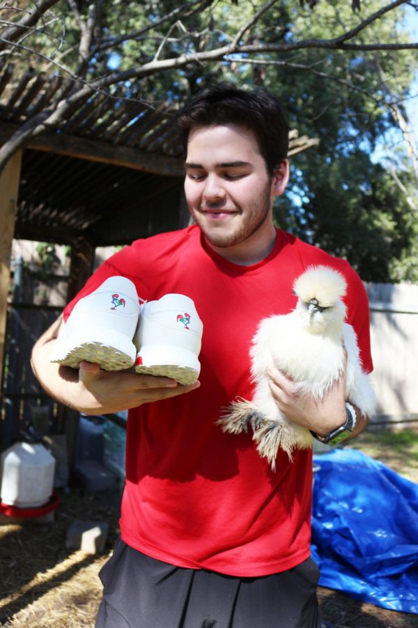 HANDS FULL: Blake Guerra poses with his hen and his rooter pair of shoes to match with her. Guerra finds reselling shoes as a way for him to share his passion with others.
