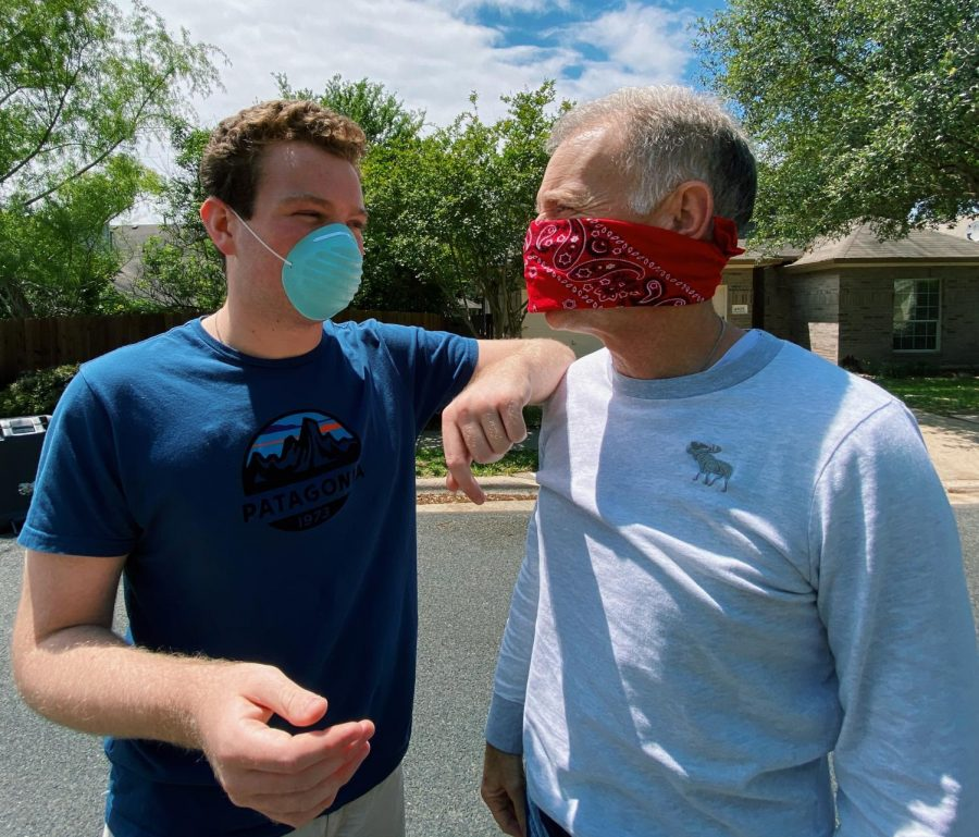 Junior Cade Spencer and his dad, Randy Spencer, wear masks while taking a walk around their neighborhood. As of Tuesday, April 14, the City of Austin expects all residents over the age of 10 to wear masks when in public areas or when six feet of physical distance cannot be easily maintained.