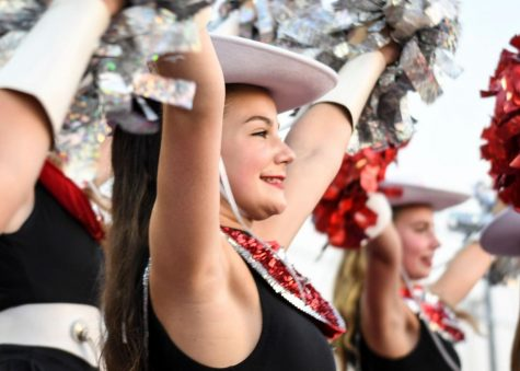 Sophomore Keira Folkers cheers alongside her Silver Stars team at a Bowie football game. As a member of the Silver Stars dance team, Folkers has to participate in three online workouts each week to prepare for the fall season.