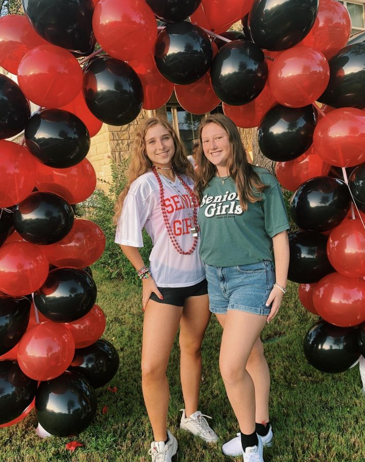 Seniors Amelie Hayne (left) and Sarah Clements (right) celebrate the start of senior year while wearing the traditional senior shirts. For the first time, senior shirt designs will be made for both senior girls and guys for the Class of 2021.