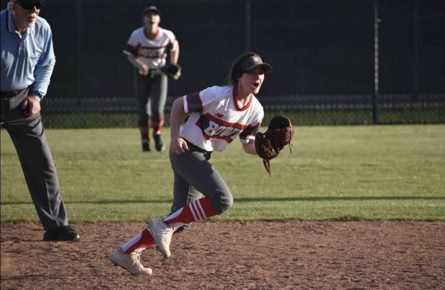 Senior+Emily+Lear+runs+across+the+field+with+her+eyes+on+the+ball.+She+played+middle+infield+and+outfield+on+varsity+before+the+season+was+cut+short.