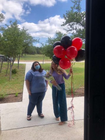 Senior Ava Nielsen stands outside of her house with the Student Council sponsor Kaylin Brett, who gave her balloons and flowers. The student council also wrote Nielsen a letter congratulating her on her win.