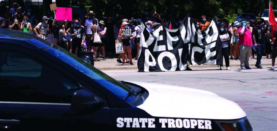 CITYWIDE TENSION: State Trooper patrols Black Lives Matter protest in Austin. In August, the City Council voted to reallocate one-third or $150 million of the $434 million initial APD budget.