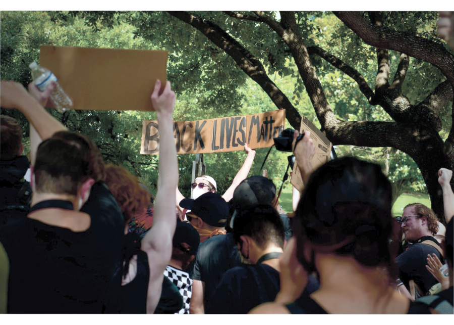 PROTESTS+IN+AUSTIN%3A+Protesters+hold+up+Black+Live+Matter+signs+at+a+march+against+police+brutality.+The+pro-+tests+began+after+the+death+of+George+Floyd+and+continued+throughout+the+summer.+